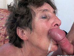 Watch this horny and lustful granny Lidy attacking on young handsome stud's big cock, she waste no time and removes her clothes off and start sucking that big cock, who fucks her hairy pussy hard and deep till he shoots his cum load on her face.