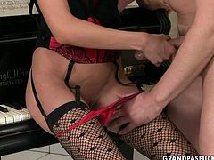 Kinky young hoe is sassy lingerie and black stockings is ducking juicy cock of her music teacher. Then she bends over the piano getting banged hard from behind. Damn, Girl, I can teach you music better than he does.