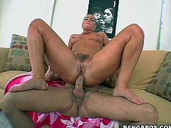 Slutty blonde Flower Tucci licks and rubs her man's prick. Then she takes the shaft into her butt and jumps on it in cowgirl position.