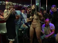 Dana Vixen gets tied up and fingered in public in some strip club. She sucks dicks and gets her hot pussy drilled.