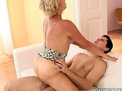 This short-haired mature slut knows a lot about pleasing men. She sucks her young lover's cock passionately to make it hard and ready. Then she takes his rock hard erection for a long ride. Press play and enjoy the action.