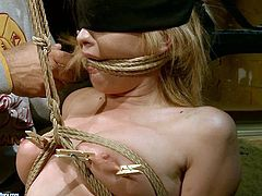 Cum addicted pallid blondie is blindfolded and tied up with ropes. Submissive nympho stands on knees and gives a stout blowjob to a dominant horny dude obediently. Check out this 21 Sextury bondage sex clip to jizz at once.