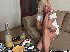This lonely granny takes a surprise package of two cocks in her mouth and in her nice shaven pussy.