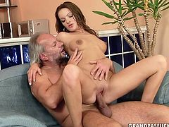 Skanky long haired brunette amateur named Anna is obliged to serve a horny bearded daddy. She climbs on his sturdy cock for a ride reverse before switching to missionary position.