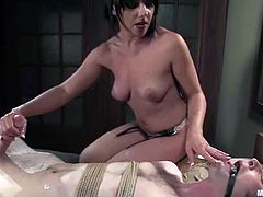 Horny brunette chick sucks a penis with great passion. After that she ties the guy up and gives him a handjob.