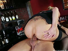Dirty like mud and sexy like a goddess blondie works as a bar woman. This busty and booty nympho in black stuff is too cum hungry. So whorish chick sucks her client's dick and rides his tool madly on the counter right in the bar.