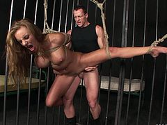 Dude, you're welcome to hot bondage session. Kinky busty and booty gal gets tied up with ropes. She stands and gets her wet pussy as well as butthole drilled tough in the prison cell.