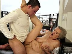 Kinky grannie enjoys rough sex with hot tempered young dude. He polishes her cunt and plays with her saggy tits. Later he dives between her legs and pleases her hairy muff.