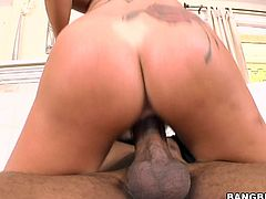 Have a look at this babe's great ass and massive round tits in this interracial video where her wet pussy's nailed by a black monster cock.
