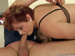 Ample red-haired mature BBW with a sultry tattoo on her tit gives a steamy blowjob to mini dick wearing seductive black lingerie in steamy sex video by 21 Sextury.