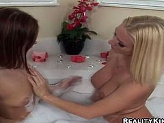 Yevanne and her awesome GF are getting naughty in the bathroom. They play with each other's pussies in the bathtub and then poke a dildo into each other's pink caves.
