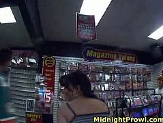 Slutty brunette bitch is having fun in the shop. She pulls up her skirt flashing wet pussy in front of the customers. They go nuts.