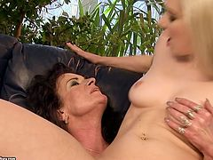 Nasty blondie with slender body and sweet tits is fond of sex with old ugly lesbians. Tonight wondrous cutie sucks a strapon and eats mature wet cunt of short haired old brunette right on the couch.