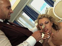 Hot blonde milf Kristi Lust wearing a white apron is getting naughty with some stud indoors. She shows him her holes and lets him drive his dick into her butt and pound it deep and hard.