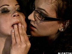 Shabby looking brunette MILF stands still bandaged with her leg pulled up while a rapacious mistress pins her mouth, tits and inner part of her tight with clothing pegs in BDSM sex video by 21 Sextury.