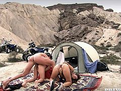 Claudia Rossi and exotic cutie Lady Mai are having some good time with a guy in the mountains. They suck his prick remarcably well and then stand on all fours and allow the man to fuck their vags doggy style.
