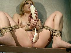 Are you fond of bondage? Then you'll surely like this steamy 21 Sextury xxx clip. Kinky blondie with pale tits is tied up with ropes. She's given a black dildo to fuck her wet pussy right on the table.