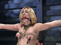 Sexy blondie is experiencing some painful things. She gets tied up and bondaged. Then her master inserts a ball gag in her mouth, making her be silent!