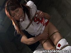 Check out this great-looking Asian cheerleader ready to expericence her first BDSM action. She is all tied up and her ass is about to get spanked really hard!