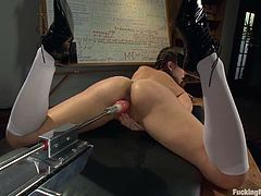 Cute brown-haired chick Remy LaCroix is having fun in a classroom. She gets her juicy snatch drilled by a fucking machine and seems to enjoy it much.