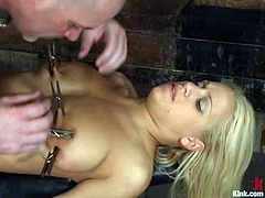 The blonde beauty Mia Bangg is the one having rough hardcore sex in a bondage and domination session where her pussy is fucked hard.