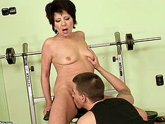 Mature woman seduces the guy that is half of her age. He eats her pussy in the gym making her moan load with joy and pleasure. Then she gives him stout blowjob applying all her tricks and skills gained throughout her long life experience.