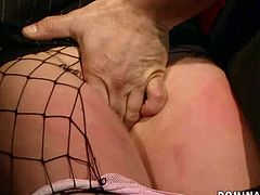 Ample blond MILF gets tied with rope by perverse dude who squeezes her snatch with a metal peg through a hole in fishnet pantyhose in BDSM-involved sex video by 21 Sextury.
