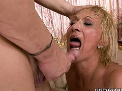 Trashy blonde granny is riding hard stick of young stud