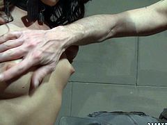 Kinky master bandages voluptuous brunette doxy and forces her stand in doggy pose before she proceeds to eating dog food from bowl placed on dirty floor in perverse BDSM sex video by 21 Sextury.