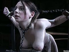 Naughty brunette girl gets tied up and gagged. After that she gets her pussy gaped and toyed with special devices.