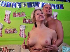 Blonde chick Sarah Vandella with fake tits and hot ass masturbating while she gets fucked missionary by Porno Dan in studio apartment.