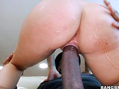 Watch this brunette's tight pussy getting stuffed by this guy's black monster cock after she sucks on it. See how she ends up with her face covered by cum.