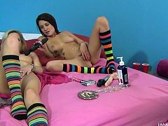 Sweeties are using a big strapon to stimulate both their wet pussies