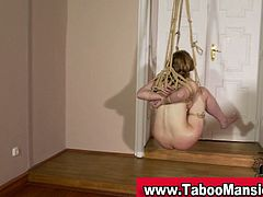 Hot blonde babe is forced get bck naked and is tied up by her master. Bound hoe can't move, her master slides a big long toy deep inside her pussy and she gets wet.