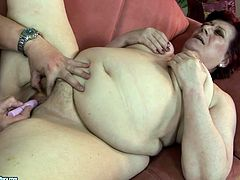 Horny dude gonna make this obese old brunette moan of delight. He plugs a pink dildo into her mature pussy and drills it properly. Fat whore with saggy tits and huge ass groans right away.