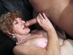 Gang banging blonde granny Kathy Jones and she enjoys being in the middle of these interracial huge cocks around her. She strips naked leaving only her stockings and opens all her holes for extreme fuck.