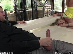 While one of the blondes gets fucked in the ass, the other one is sucking her toes and playing with her pussy. The guy cums in their mouths and they swap.