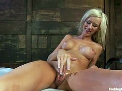 Stunning blondie sucks big dildo and gets her pussy toyed from behind. Later on she also gets her tight ass drilled.