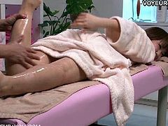 See a horny and intense Asian brunette temptress getting her hot body oiled and massaged by her man.