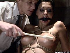 This horny bondage master has a rich imagination when it comes to torturing his sex slaves. He binds his slave's wrists in rope to ensure she can't wiggle her hands free. Then he pokes her snatch with sex toy.