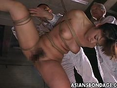 Lovely busty asian babe gets dominated here.
