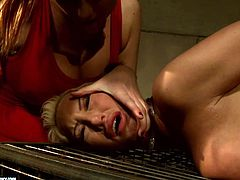 Shabby looking blond MILF lies on her belly bandaged by a rapacious domina before she starts giving her an erotic massage in peppering BDSM-styled sex video by 21 Sextury.