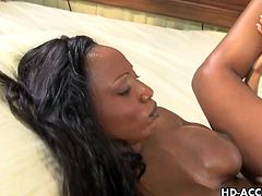 Wow, Diamond Jackson is blessed with a firm and round pair of tits.  And when this ebony babe gets fucked with a white dick they bounce around and look simply amazing.