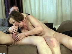 This old woman is a super qualified slut when it comes to pleasing men. She gives her lover a sloppy blowjob and then she rides him in reverse cowgirl position.