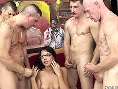 Provocative wench with insatiable cock hunger is sucking four juicy cocks in a row. She serves them all well so they cum on her ugly face giving her bukakke.