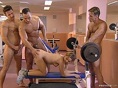 Vanda is getting penetrated by three men in the gym