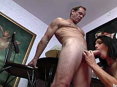 Nasty brunette tranny is wearing tiny black dress looking pretty feminine. She gets down on her knees taking hard dong in her mouth. Slutty shemale gives deepthroat blowjob.