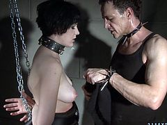 Brunette floosie is chained and punished by horny stud. She moans in pain while stud teases her pussy and pills her hair in bdsm sex tube video from 21 Sextury porn site.