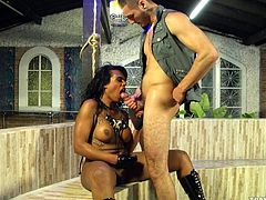 Alessandra Molinari grabs onto rope for support, as her master fucks her ass up. She's made to suck his big thick cock. She licks the tip of it and he rubs his dick all over her lips.