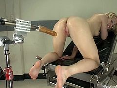 Sexy blonde chick sits on a table and toys her pussy with a vibrator. Then she lies down on a medical chair and gets toyed from behind.